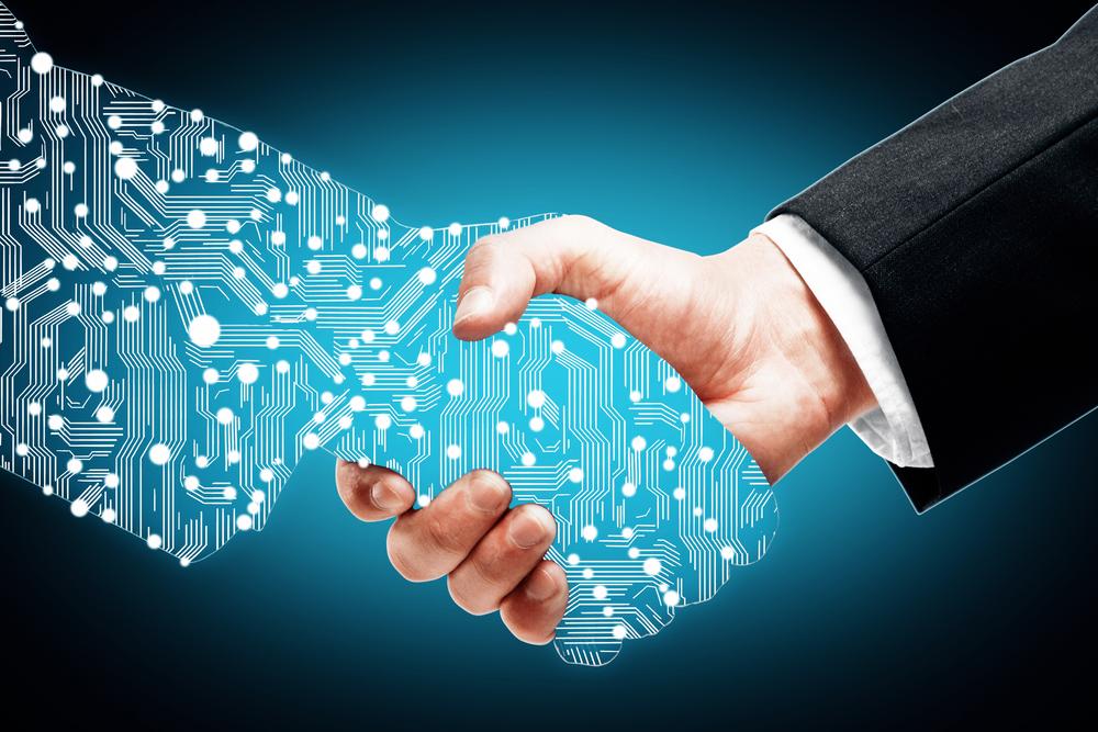 Businessman shaking digital partners hand